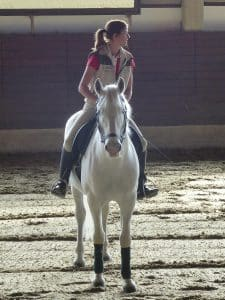 Girl at english horseback riding lesson